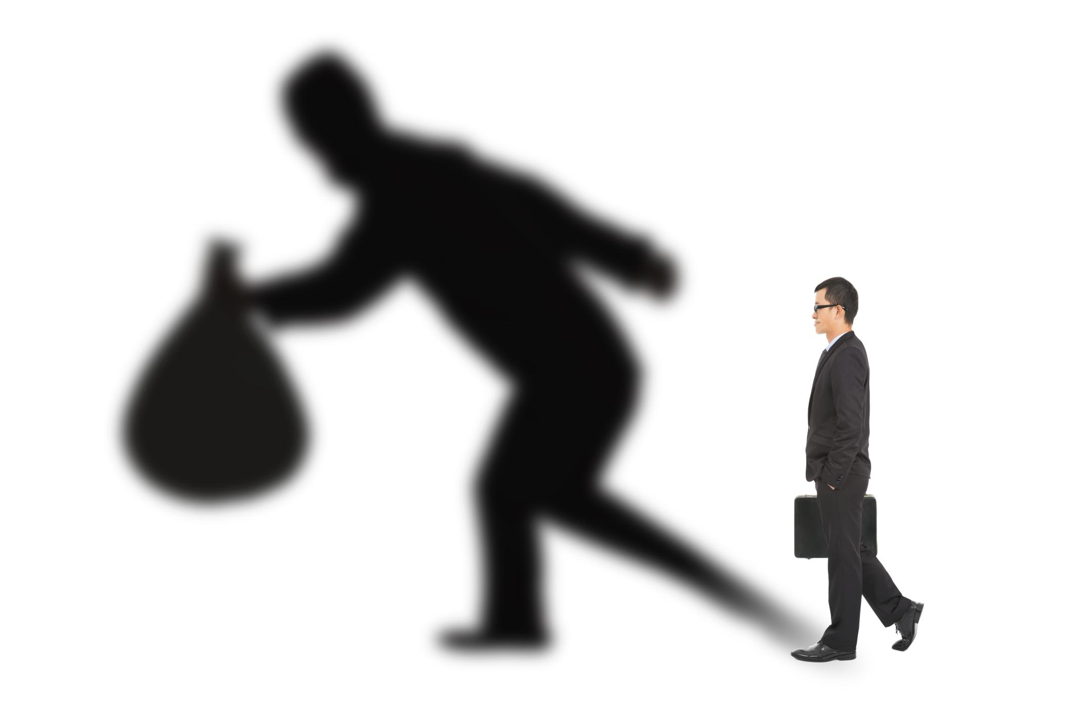 a financial fraudster stealing millions
