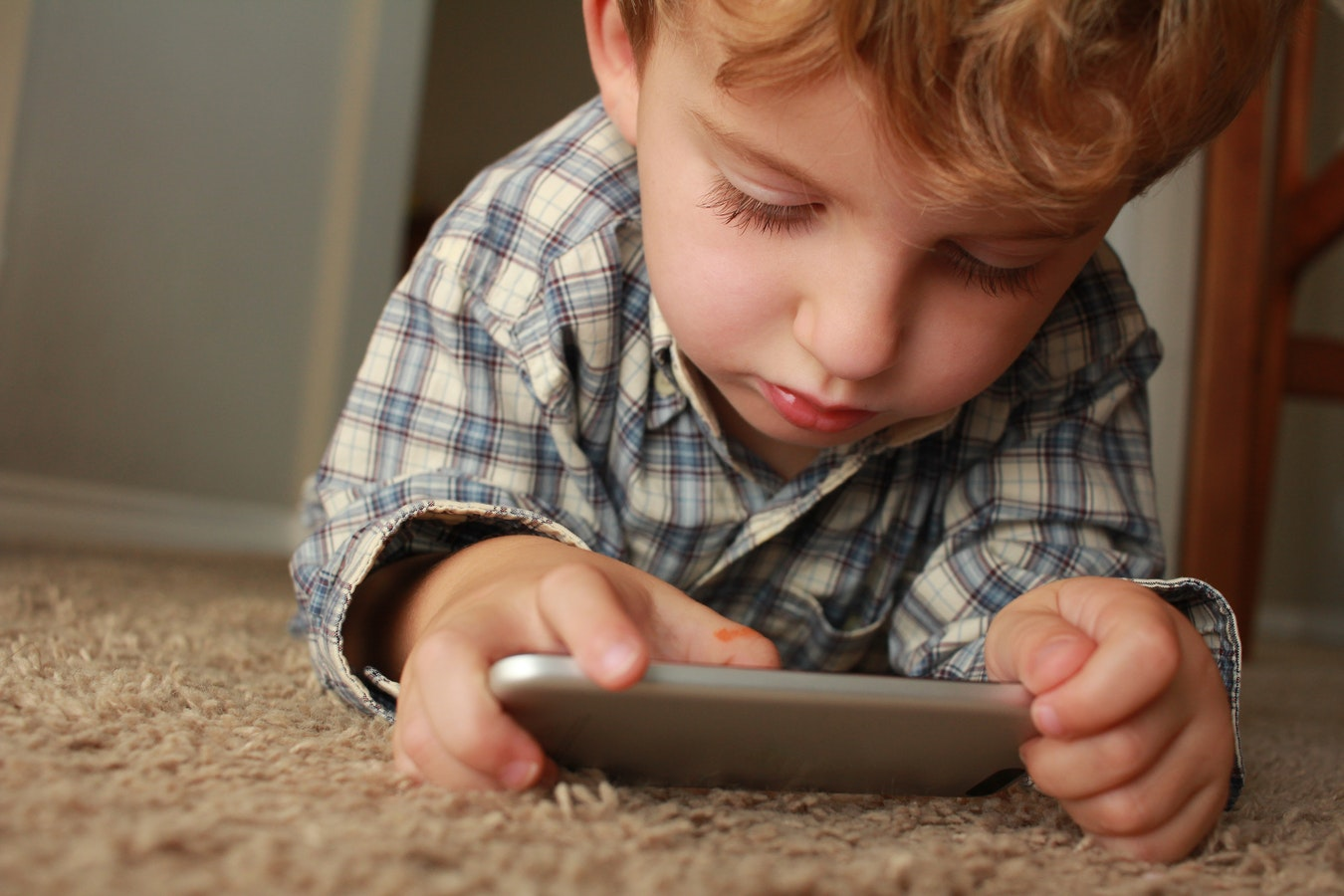 child playing with android apps from google family store